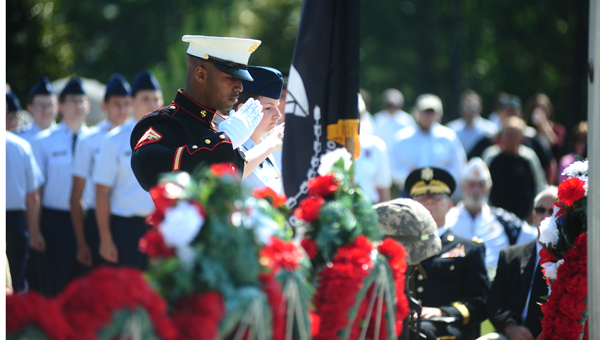 Families and other military members show their respect to fallen heroes.