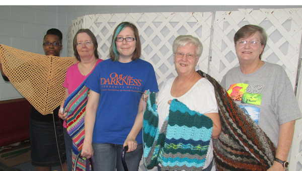 Kimberly Shepheard, Linda Harris, Elizabeth Cottle, Alberta Coulter and Kathy Hardin with Charlie Major, the service dog. (Contributed.)