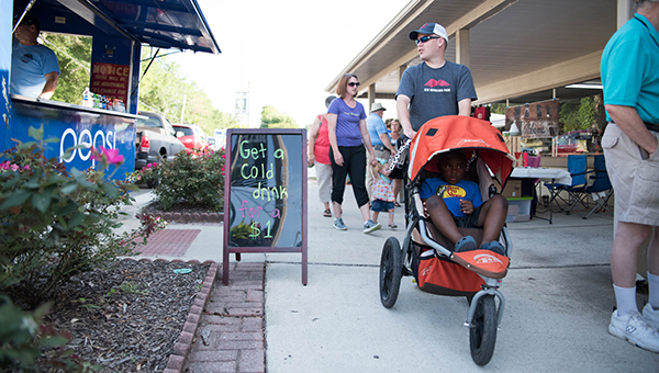 Families scope out the vendors at Helena First Friday. The July First Friday event is expected to be the largest of the year and begins at 5:30 p.m. on July 1. (File)