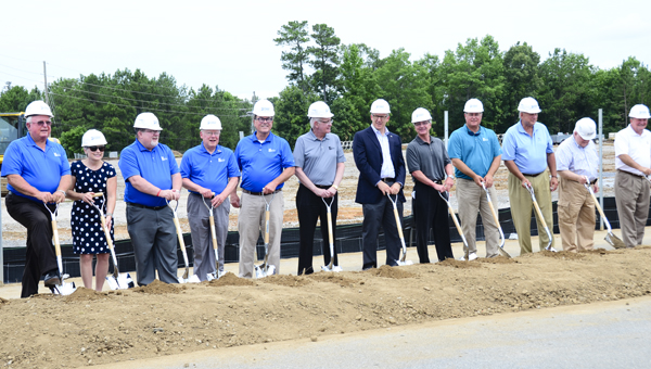 Donning hard hats, Hoover city officials and other dignitaries dip shovels into the dirt at a June 14 groundbreaking ceremony for the new Hoover Sports and Events Center, which will be located on 120 acres next to the Hoover Metropolitan Stadium. (Reporter Photo/Emily Sparacino)