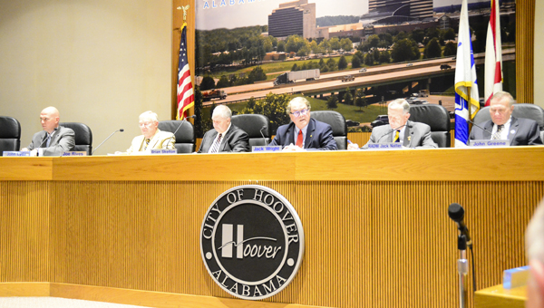 The Hoover City Council engages in discussion at a June 6 meeting, where members passed ordinances on the regulation of door-to-door peddlers and allowing individuals to carry firearms in city parks. (Reporter Photo/Emily Sparacino)