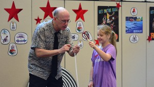 Rachel Crowe, right, helps magician Russell Davis during the show. (Reporter Photo/Neal Wagner)