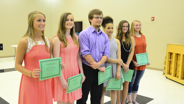 From left, Karlee Cardwell, Amy Copes, Christopher Davis, Jada Harris, Zoe Thomas and Chloe Vick are the South Shelby Chamber of Commerce's 2016 scholarship recipients. Each student received a $1,000 scholarship. (Reporter Photo/Emily Sparacino)