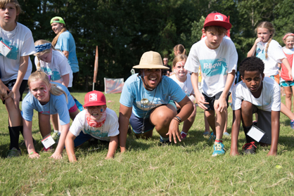 "Campers play a game of ""hungry hippo."""