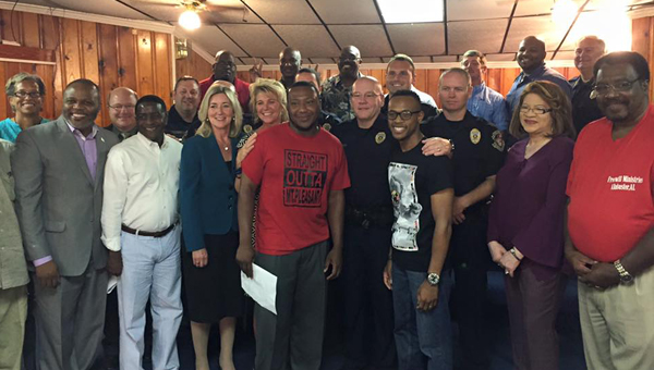Local pastors, officers and community leaders stand together after a night of prayer and thanks dedicated to the Alabaster Police Department at Freewill Missionary Baptist Church in Alabaster on July 14. (Contributed)