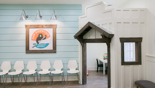 Oak Mountain Pediatric Dentistry is designed to be kid-friendly, including the inclusion of a playhouse. (Photos by Rob and Wynter Photography)