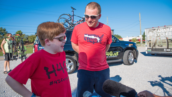 """Gabe Griffin and Michael Staley talk to media members July 26 at a departure event for """"Ride4Gabe."""" (Photos by Keith McCoy)"""