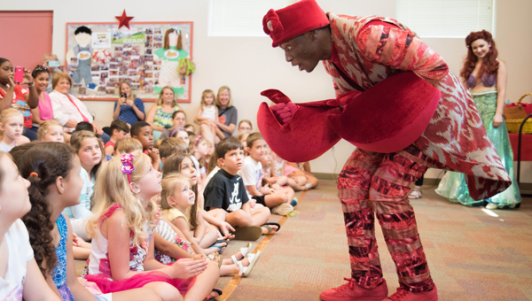 Sebastian the crab, played by Brandan McCall, entertains attendees of the Albert L. Scott Library's Fun Finale to summer reading July 13. (Reporter photo/Keith McCoy)