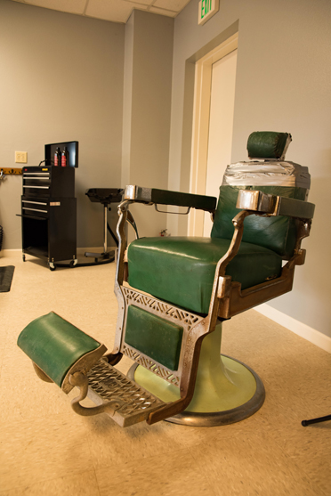 An original, 1940s barber chair from the late Reg Weldon contributes to the old-fashioned atmosphere at The Barber Shop. (Reporter Photo/Keith McCoy)