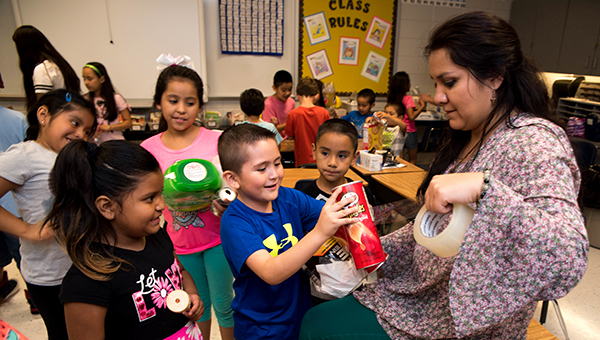 HES English Language Learning teacher Janie Blackstone, right, assists Helena ESL students at an innovation convention summer enrichment camp the week of June 27 at Helena Intermediate School. (Reporter Photo/Keith McCoy)