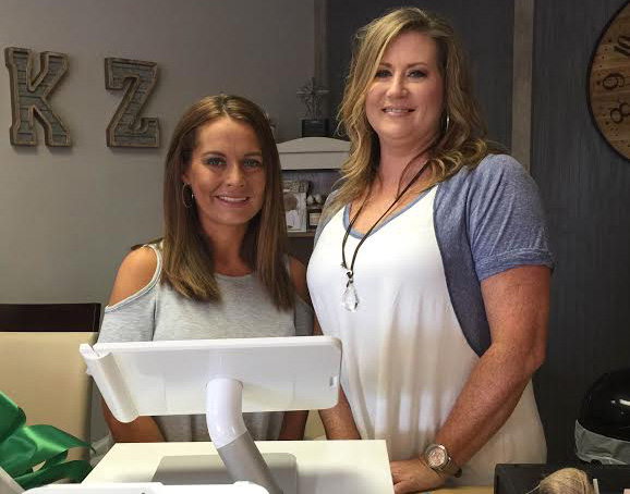 Kandace Weaver (left) and Jamie Riley (right) stand behind the counter of their clothing boutique in Pelham.(Reporter photo/Briana Harris)