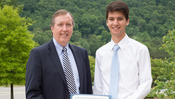 SouthWest Water Company's Harry Chandler presents the SWWC scholarship to Daniel Stanton of Oak Mountain High School. (Contributed)
