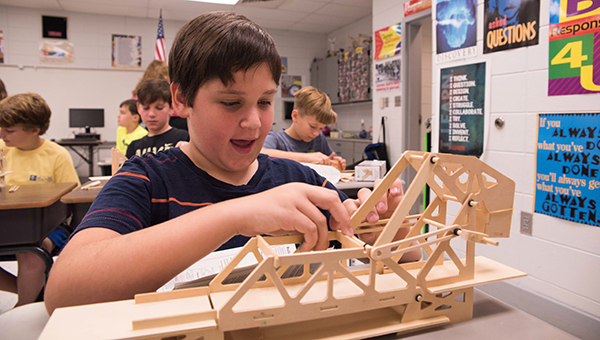 Upcoming HIS fifth grader John Robert works on his Strauss Bascule bridge at the Camp Build enrichment camp on Tuesday, July 12. (Reporter Photo/Keith McCoy)