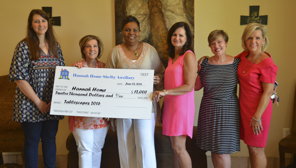 Hannah Home Shelby Auxiliary members present a $12,000 donation check to King's Home Shelby director Gwen Solomon, third from left, on June 23. Also pictured are, from left, Ashley Jett, Janie Dollar, Pam Bradford, Tammy Hogue and Jane Scott. (Reporter Photo/Emily Sparacino)