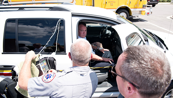 Members of the Alabaster Fire Department hook up monitors to Alabaster Fire Marshal Chief Chip Brantley prior to him sitting in a parked car in extreme heat on Friday, July 8. (Reporter Photo/Keith McCoy)