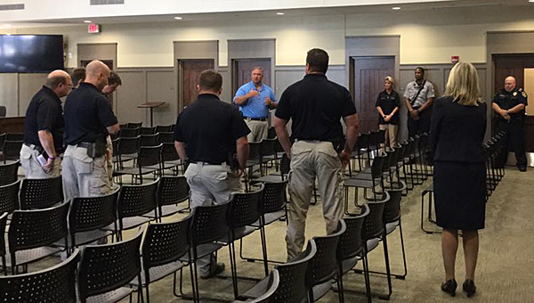 Alabaster law enforcement officers join city leaders in a moment of prayer for the Dallas Police Department at noon at Alabaster City Hall on July 8. (Contributed)