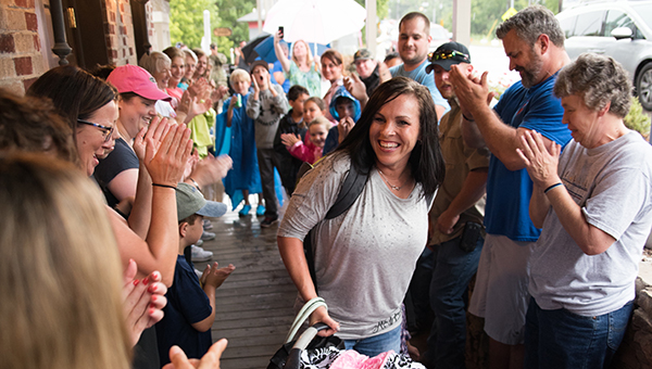 Helena community members applaud a member of the Helena Police Department as she walks into The Coal Yard on Tuesday, July 12 to enjoy a free meal. (Reporter Photo/Keith McCoy)