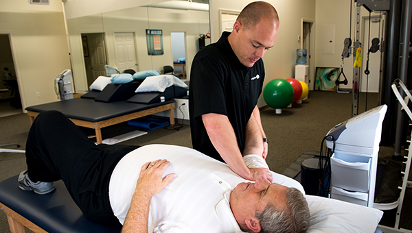 Helena TherapySouth Service Director Nolan Williams works on a patient in the newly opened therapy practice located at 4690 Highway 17 in Helena. (Reporter Photo/Keith McCoy)