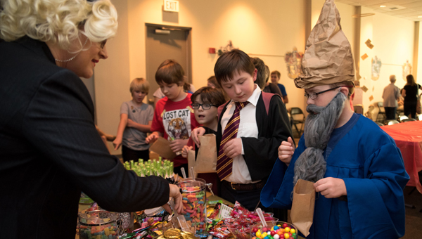 """Attendees enjoy an """"open candy bar"""" at North Shelby Library's Harry Potter celebration on July 29. (Photos by Keith McCoy)"""