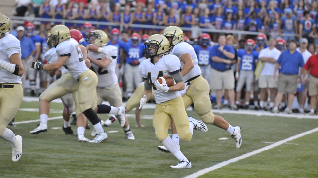 Briarwood's Carson Eddy looks for room to run on Aug. 19 during the Lions' preseason jamboree with Vestavia Hills. (Contributed / Randy Glover)