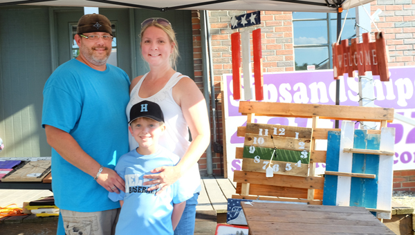 Jen and Scot Newman started their business, JnS Treasured Creations, earlier this year. Together, they make furniture, plaques, decor and other gifts to sell at area events. (Contributed)
