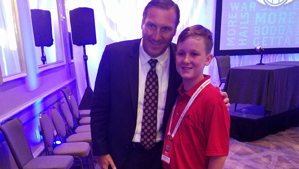 SI Kid Reporter Jack Ronilo, right, asked questions of Mississippi State football coach Dan Mullen at SEC Media Days and spent some time with the coach afterward.