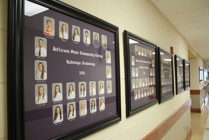 Pictures of program graduates line the walls at Jeff State's Shelby-Hoover Campus.
