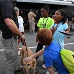 Attendees of Hoover's National Night Out talk with Hoover Police Officer Mike Davis and pet K9 Tank on Aug. 2. (Photo by Stephen Dawkins)