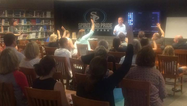 Dustin Chandler speaks to attendees of a Special Education Community Alliance on Aug. 3 at Spain Park High School.