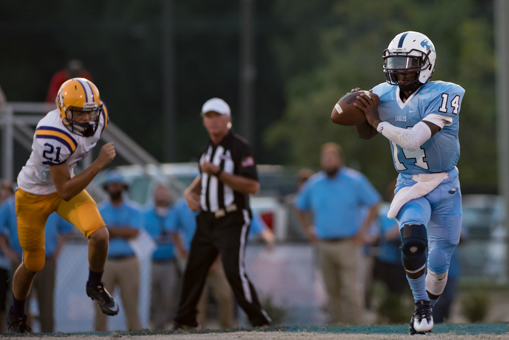 Jermaine Ross rolls out during Calera's Aug. 26 game against Bibb County. Ross and the Eagles put up 49 points on the Choctaws and won 49-34. (Reporter Photo / Keith McCoy)