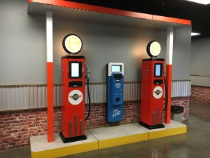 Vintage themed gas pumps serve as a check in station when kids enter The Garage.