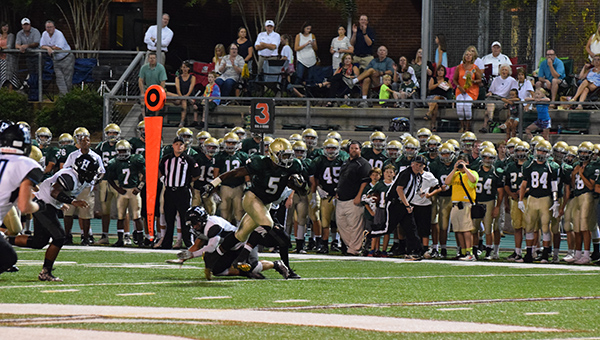 Mountain Brook running back Harold Joiner (5) finished with 131 yards on 20 carries and two touchdowns in the Spartans 21-14 victory against Helena on Friday, Aug. 26. (For the Reporter/Brian Vansant)