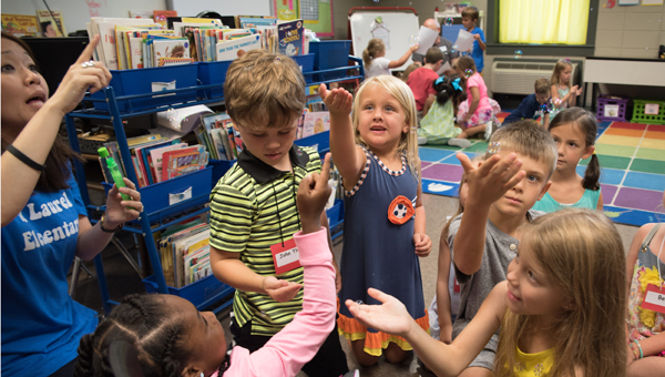 Kids play with magic bubbles on the first day of school in Mrs. Pates first grade class. (Reporter photo/Keith McCoy)