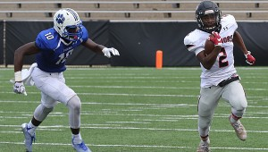 Thompson's Corey Burroughs, right, sprints past a Godby (Fla.) defender during the Warriors' 27-14 victory over the Cougars on Aug. 27 in Mobile. (Special to the Reporter/ Eric Starling)