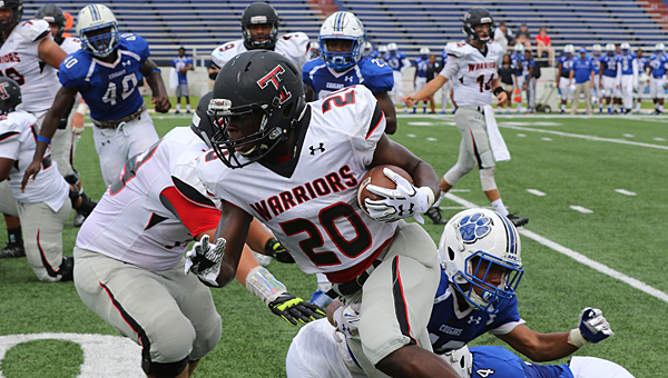 Thompson running back Shadrick Byrd (20) carries the ball during the Warriors' 27-14 victory over the Cougars on Aug. 27 in Mobile. (Special to the Reporter/ Eric Starling)