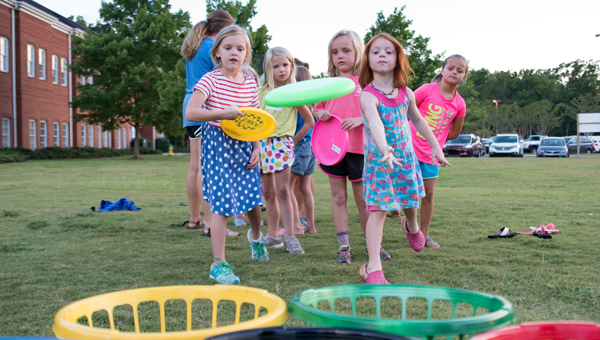 Caitlyn Crawford, Macy Williams, Lauren Craddock and others participate in Summer Olympics at Asbury United Methodist Church on Aug. 3. (Photos by Keith McCoy)