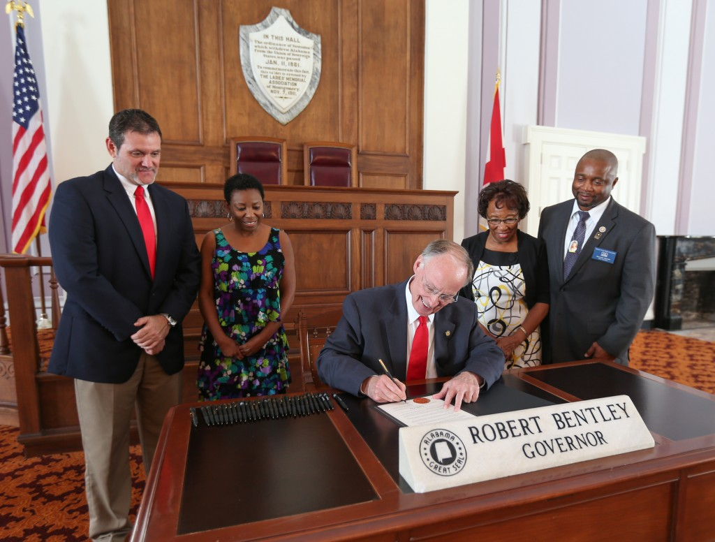 Gov. Robert Bentley signs a proclamation declaring Sept. 26 Family Day throughout the state. (Contributed)