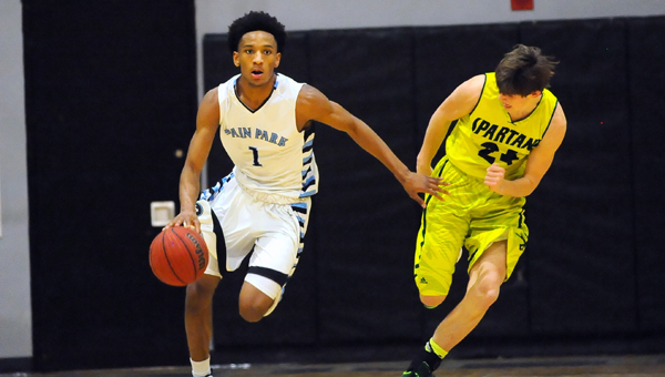 Jamal Johnson, left, shown during a game last season, committed to play college basketball for Memphis.