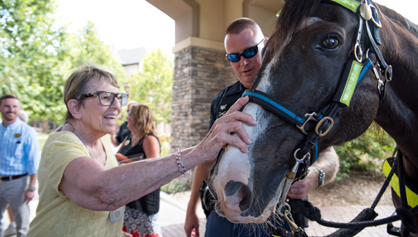 Danberry at Inverness resident Elka Joost pets Slade while Birmingham Police Department mounted unit officer Brad Herndon looks on. (Photo by Keith McCoy)