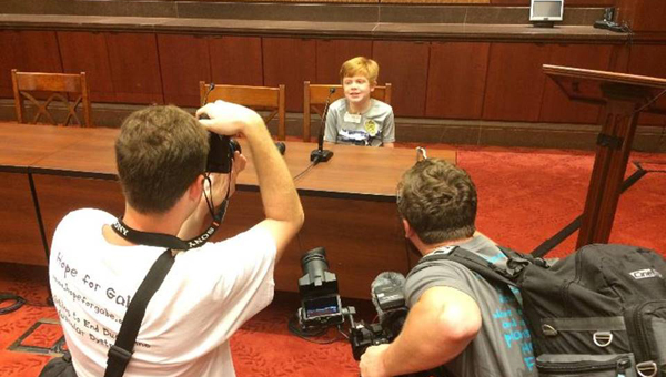 Gabe Griffin, a local 11-year old who suffers from Duchenne muscular dystrophy, prepares to speak to a room full of Congressional staffers on July 26 at the U.S. Capitol in Washington, D.C. (Photo by Andrew Garza)