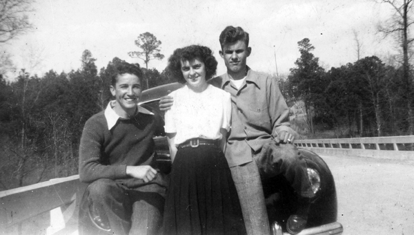 With little to do for entertainment in Helena in the 1940s, taking pictures was a favorite pastime on Sunday afternoons. One of the more popular places was the bridge over the Cahaba River on what is today County Road 52. Shown in this 1947 photo are, from left, Charles Nunnally, Edna Earl Lee and Joe Neal McClanahan. Joe died the following year in an auto accident. (Contributed/City of Helena Museum)