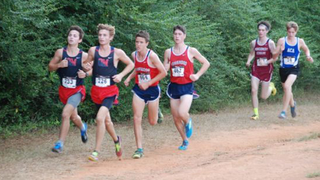 Oak Mountain's Cole Stdifole (front) and Caleb Van Geffen (left) led the Eagles in the TCBY Invitational in Tuscaloosa on Sept. 17. (Contributed)