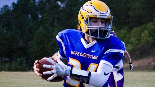 Josh Patton runs in the first of his three touchdown's on the night as Hope Christian ran over Lighthouse 60-18. (Contributed / Twanna Arnold)