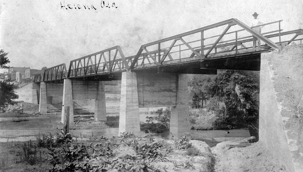 Buck Creek Bridge – Completed in 1911 at a cost of nearly $4,000, this bridge was one of the most important construction projects for Helena in years.  The piers were so well designed and built, they form the foundation of the bridge today. This photo, taken in 1913, shows what appears to be C.T. Davidson in the upper right. (Contributed/City of Helena Museum)