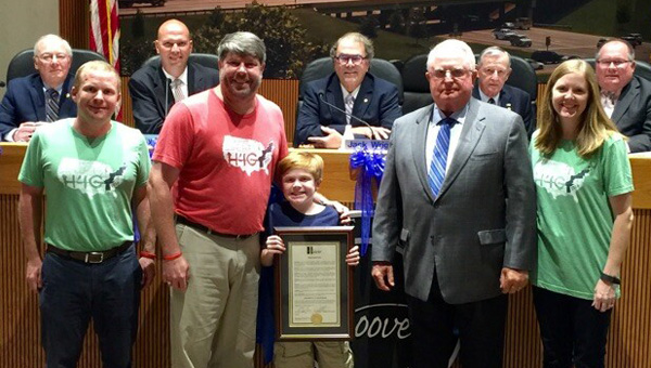 """The Hoover City Council on Sept. 6 approved proclamations declaring Aug. 7 as """"Ride4Gabe Day to End Duchenne,"""" above, and the month of September as """"Gynecologic Cancer Awareness Month"""" (below). Supporters of both causes were on hand for the presentations of the proclamations."""