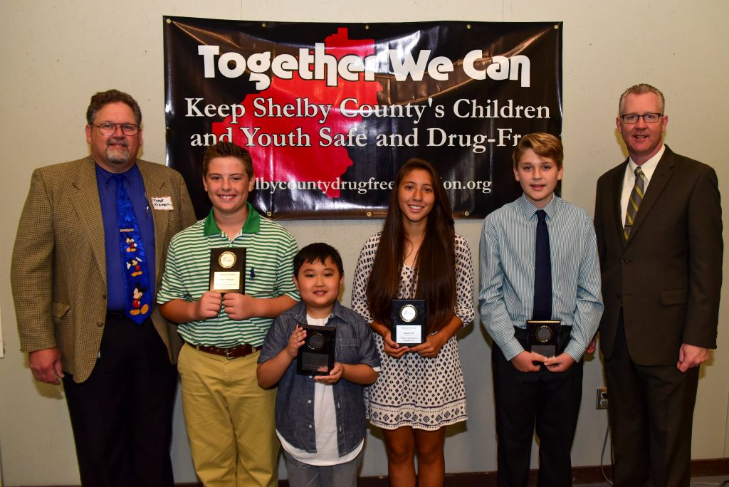 Pelham students Parker Henningsen, Justin Kim, Jaquelin Adan and Jeran Terry (from left) received Character in Action Awards on Sept. 21. They are pictured with Shelby County District Court Judge Jim Kramer (far left) and Pelham City Schools Superintendent Dr. Scott Coefield (far right). (Reporter photo/Keith McCoy)