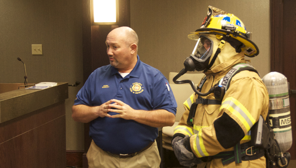 Chelsea Fire Chief Wayne Shirley and firefighter Taylor Gunnels show off the new air tanks that allow for almost 15 more minutes of breathing time, a louder voice amplifier and a beeping device that starts if the tank stays motionless. (Reporter photo/Alec Etheredge)