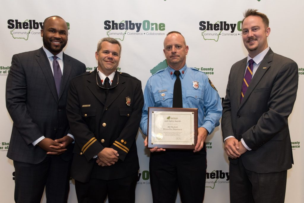 Firefighter of the Year for the City of Helena is awarded to Bill Mayfield (second from right).