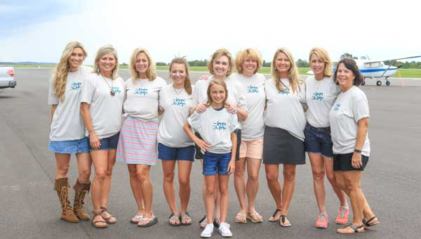 Marleigh Ingle, center, her sister Bailey, far left, and their mother, Teresa, next to Bailey, gather with members of the Hoover Kappa Delta Alumnae Chapter.