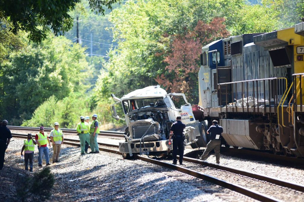 A wreck involving a vehicle and a train shuts down traffic on Lee Street at Shelby Co. 52. (Reporter photo/Keith McCoy)